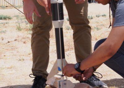 TA Fabio Bendana readies rocket for launch.