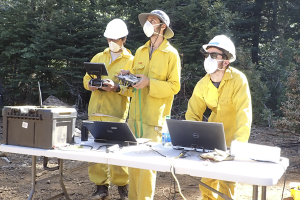 Researchers fighting fire with fire alongside other researchers at Blodgett Forest in Northern California.
