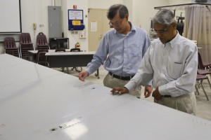 Mechanical and aerospace engineering department chair T.C. Tsao and distinguished professor Ajit Mal inspect an Airbus A330 elevator donated to the UCLA Henry Samueli School of Engineering and Applied Science on Dec. 8, 2014