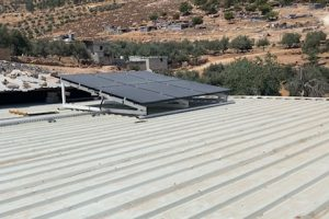 Top view of photovoltaic panels powering a residential home at the Jerash Refugee Camp.